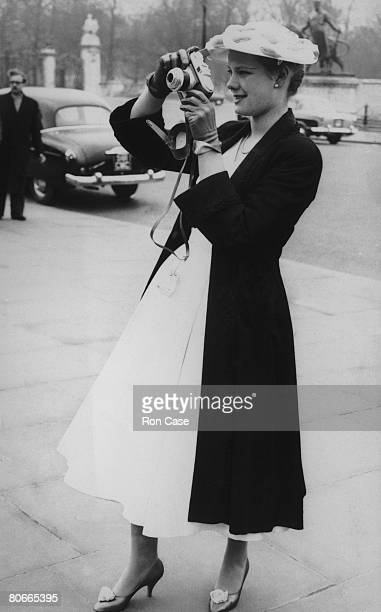 Teenage debutante Fiona MacGregor takes a picture before attending a Presentation Party at Buckingham Palace London 18th March 1958
