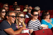 Teenage Family Watching 3D Film In Cinema