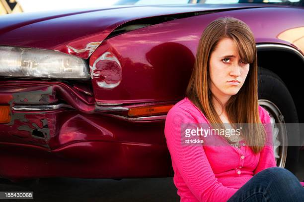 Teenage Female Driver Glares at Camera over Fender Bender