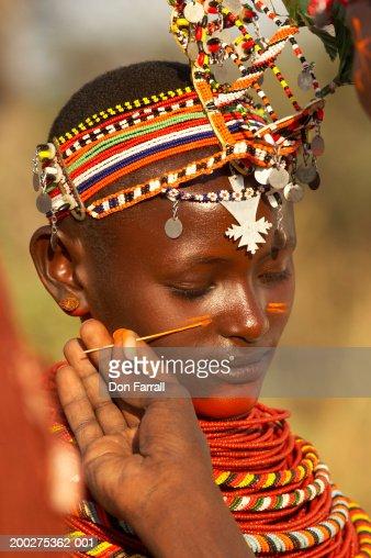 Teenage, female Samburu dancer (14-16) in costume and makeup, close-up : Stock Photo