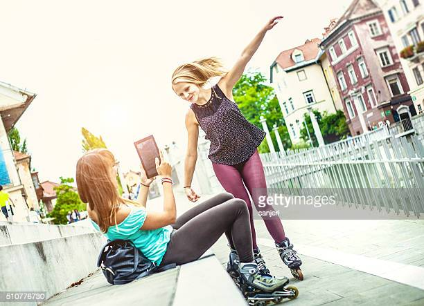 Teenage friends bonding together and having fun with rollerskate