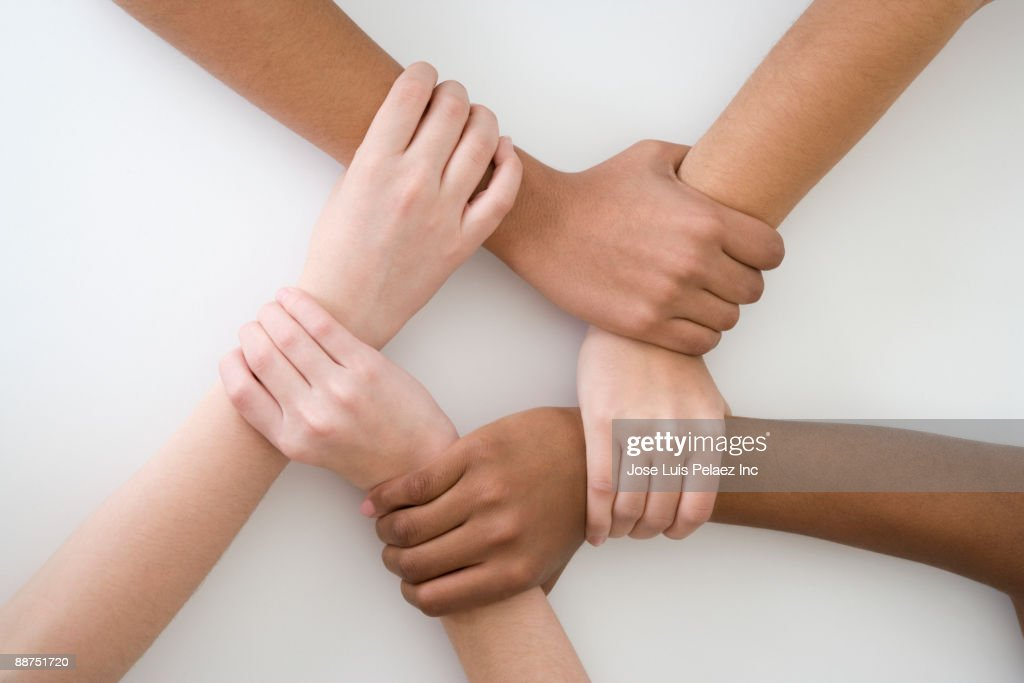 Teenage friends gripping each other's wrists : Stock Photo