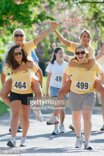 Teenage Friends having fun at a charity road race : Stock Photo