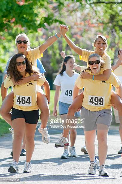 Teenage Friends having fun at a charity road race