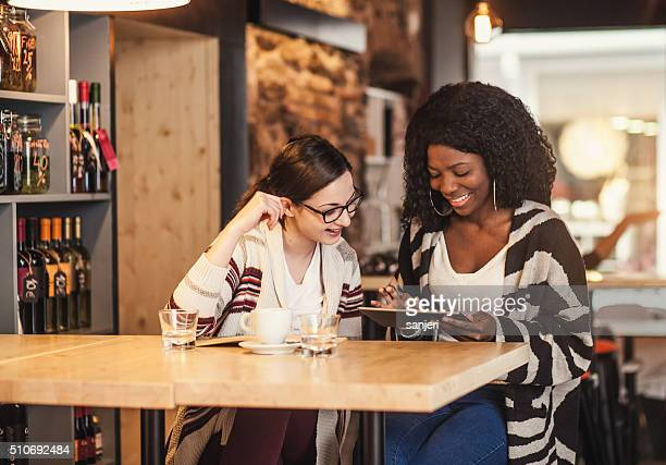 Teenage friends having fun at the coffee shop