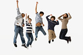 Teenage friends jumping in mid-air