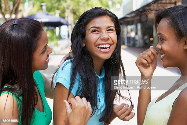 Teenage friends laughing and hanging out