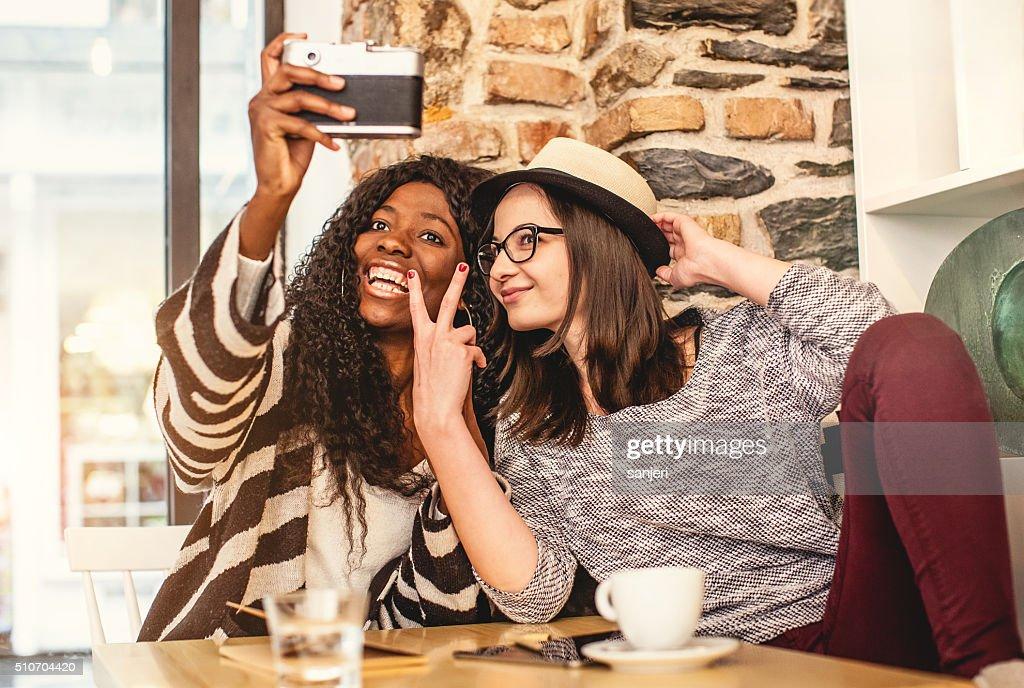 Teenage friends making selfie at the coffee shop   Stock Photo. Teenage Friends Making Selfie At The Coffee Shop Stock Photo