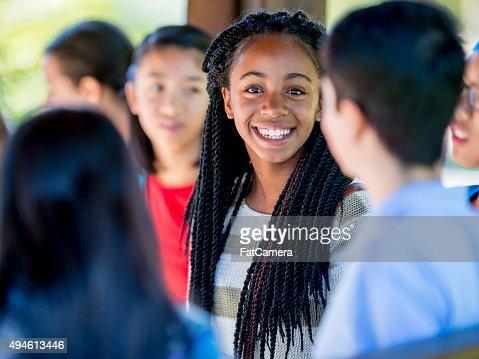 Teenage Friends Talking Between Class