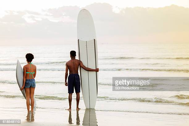 Teenage friends waiting to surf