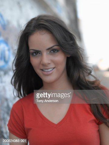 Teenage girl [16-17] in red shirt smiling, portrait. : Foto de stock