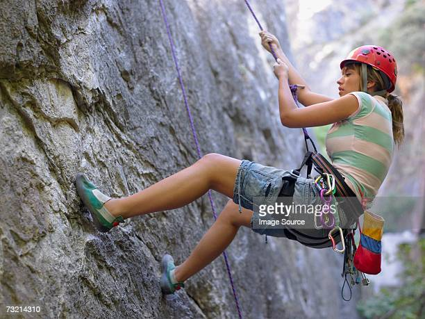 Teenage girl abseiling