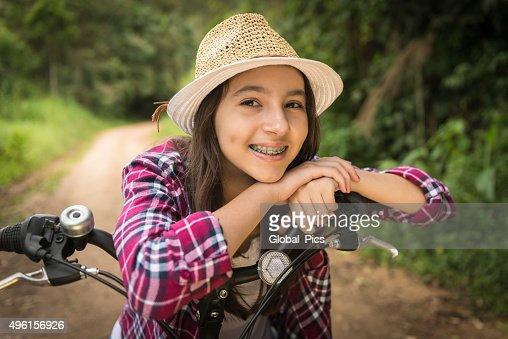 Teenage girl and bicycle