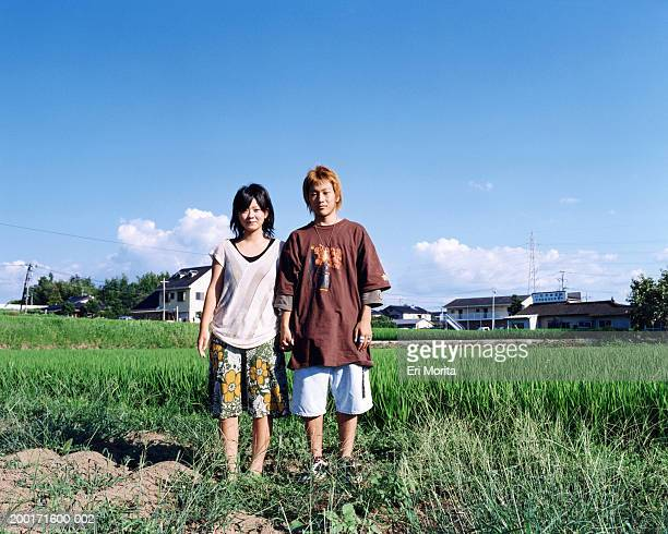 Teenage girl and boy (16-18) in open field, portrait