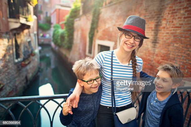 Teenage girl and ger brothers are visiting Venice, Italy