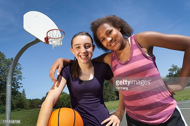 Teenage Girl Basketball Players on Outdoor Court, Two Interracial Friends