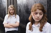A teenage girl being bullied