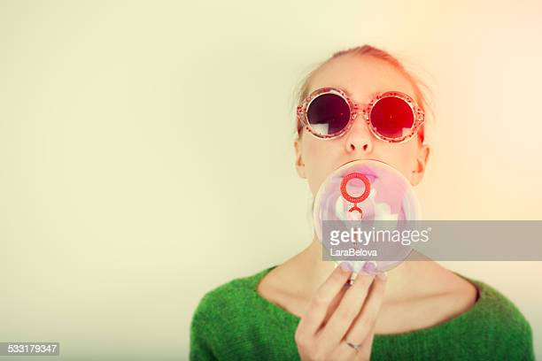 Teenage girl blowing soap bubbles