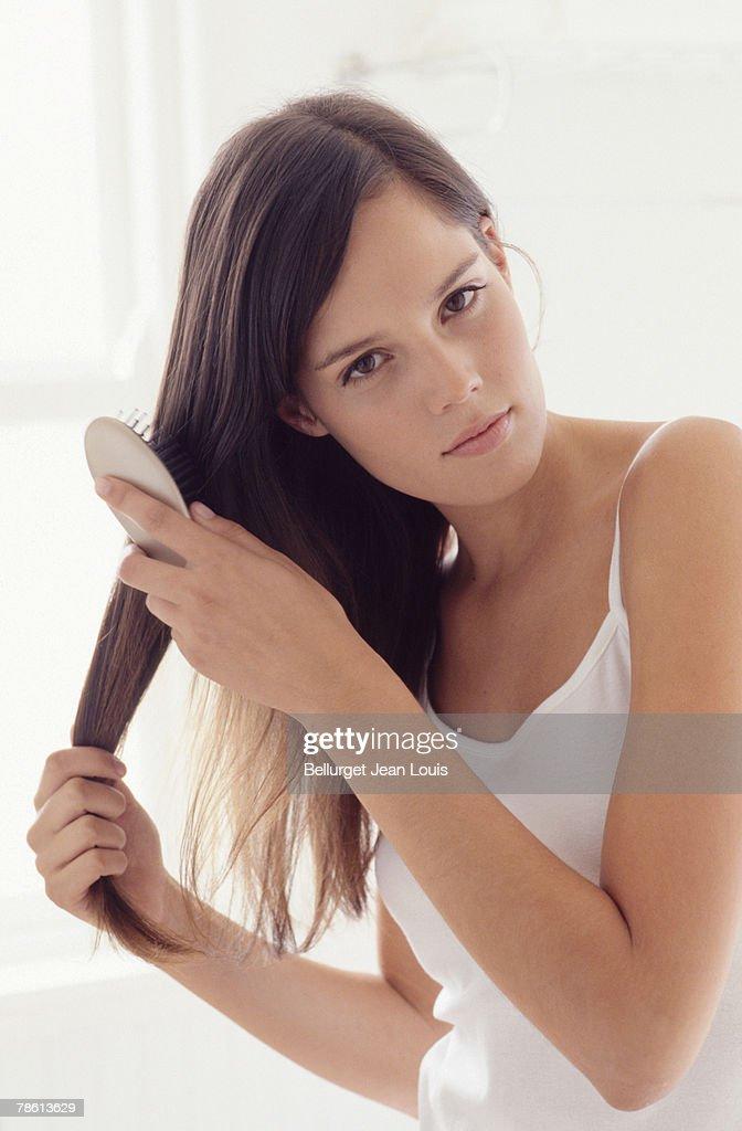 Teenage girl brushing hair
