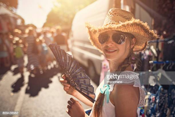 Teenage girl buying souvenirs on flea market in Andalusia, Spain
