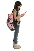 Teenage girl (12-14) carrying backpack, using cell phone, side view