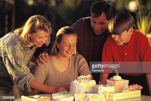 Teenage girl celebrating a birthday with her family