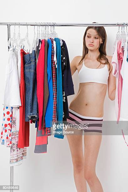 A teenage girl choosing clothes