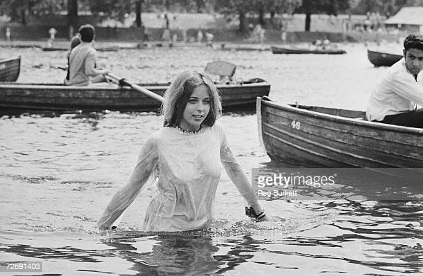 A teenage girl cooling off in the Serpentine during the Rolling Stones concert in Hyde Park London 5th July 1969