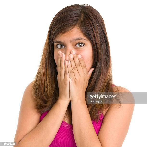 Teenage Girl Covering Mouth