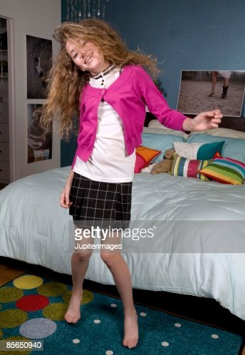 Teenage girl dancing in bedroom   Stock Photo. Teenage Girl Dancing In Bedroom Stock Photo   Getty Images