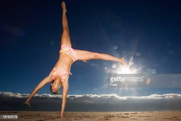Teenage Girl Doing Cartwheel