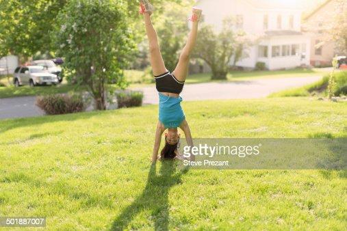 Teenage girl doing headstand