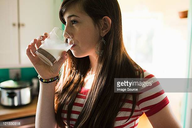 Teenage girl drinking glass of milk