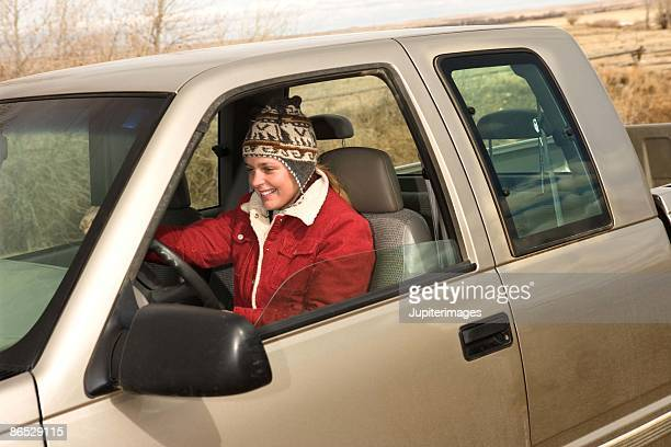 Teenage girl driving truck, Wyoming