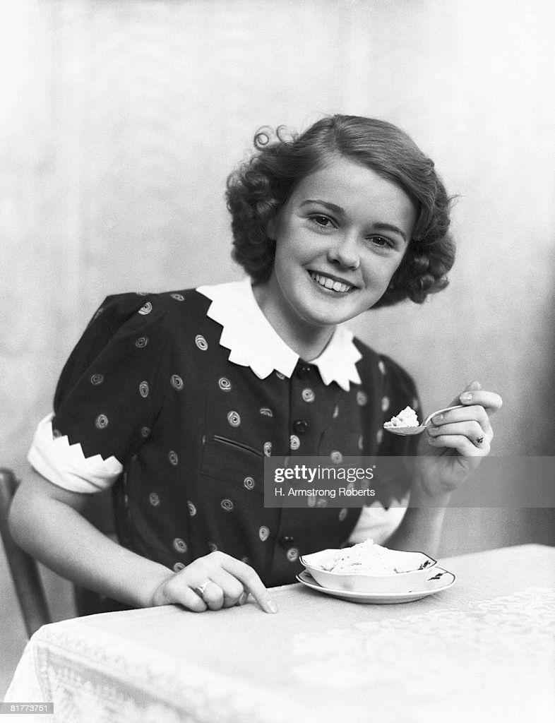 Teenage girl eating ice-cream, portrait. : Stock Photo