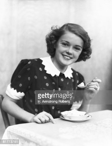 Teenage girl eating ice-cream, portrait. : Stock Photo
