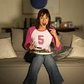 Teenage girl eating