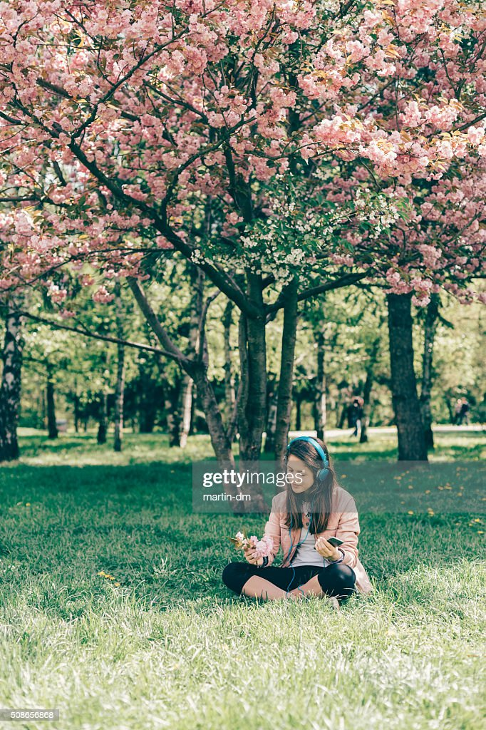 Teenage girl enjoying the music among nature : Stock Photo
