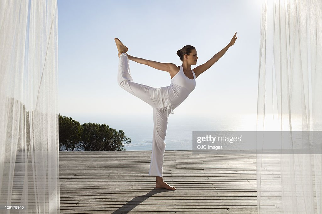 Teenage girl exercising against clear sky : Stock Photo