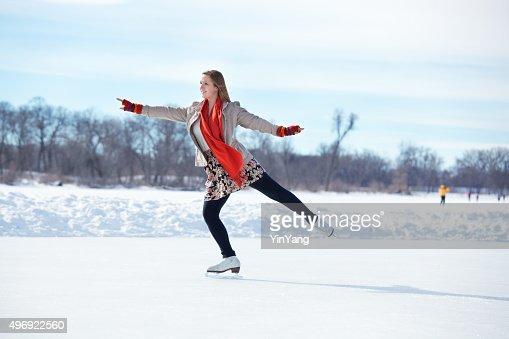 Teenage Girl Figure Skating on Winter Lake Ice Rink, Minneapolis