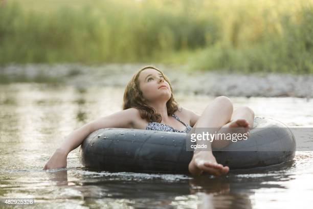 Teenage Girl Floating in Peaceful River
