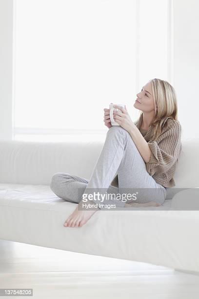 Teenage girl having cup of coffee