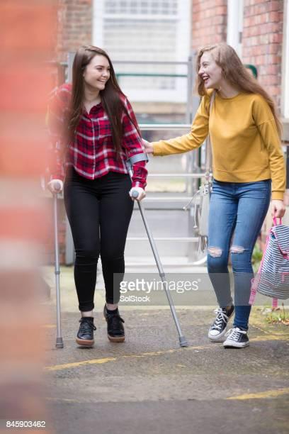 Teenage Girl Helping Injured Friend