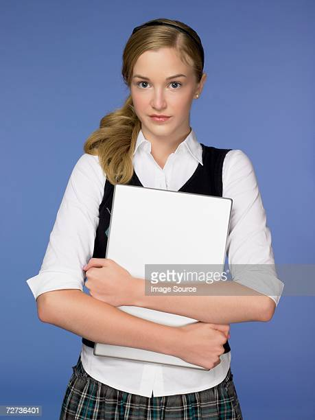 Teenage girl holding a laptop computer
