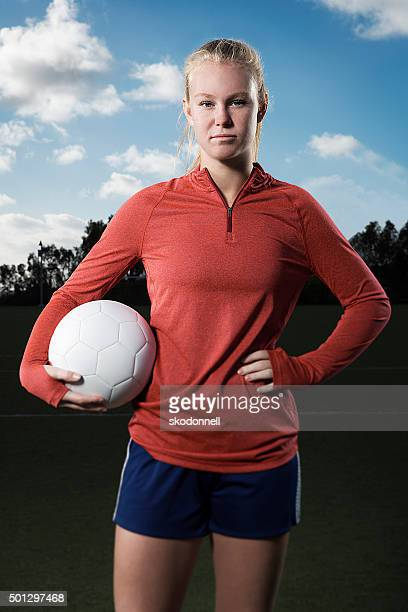 Teenage Girl Holding a Soccer Ball