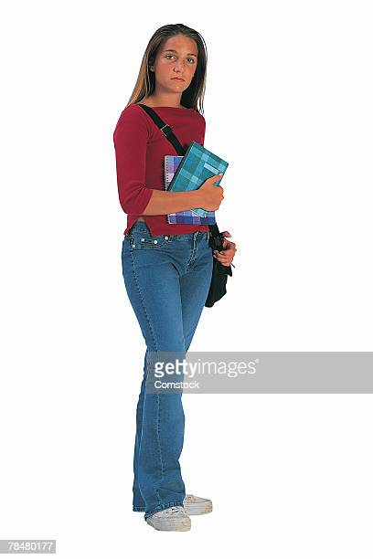 Teenage girl holding books