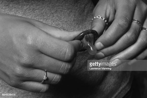 holding condom girl