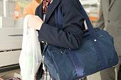 Teenage girl holding plastic bag
