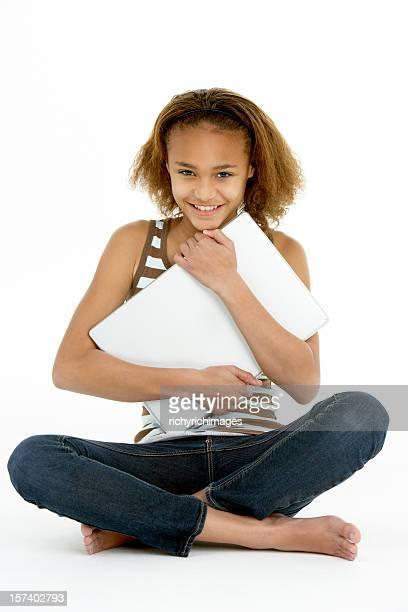 Teenage Girl Hugging Laptop