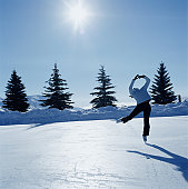 Teenage girl (14-16) ice skating